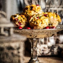 Cranberry Sage Stuffins on raised cake plate in rustic setting