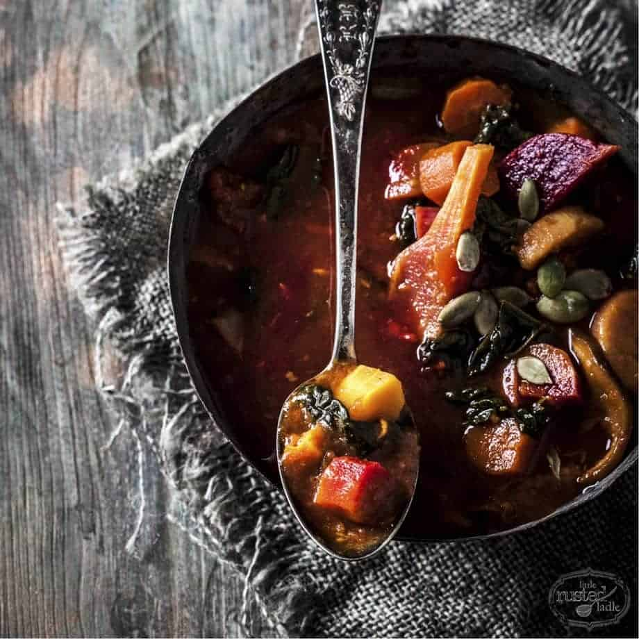 Healthy Detox Vegetable Soup with a spoonful resting across the bowl.