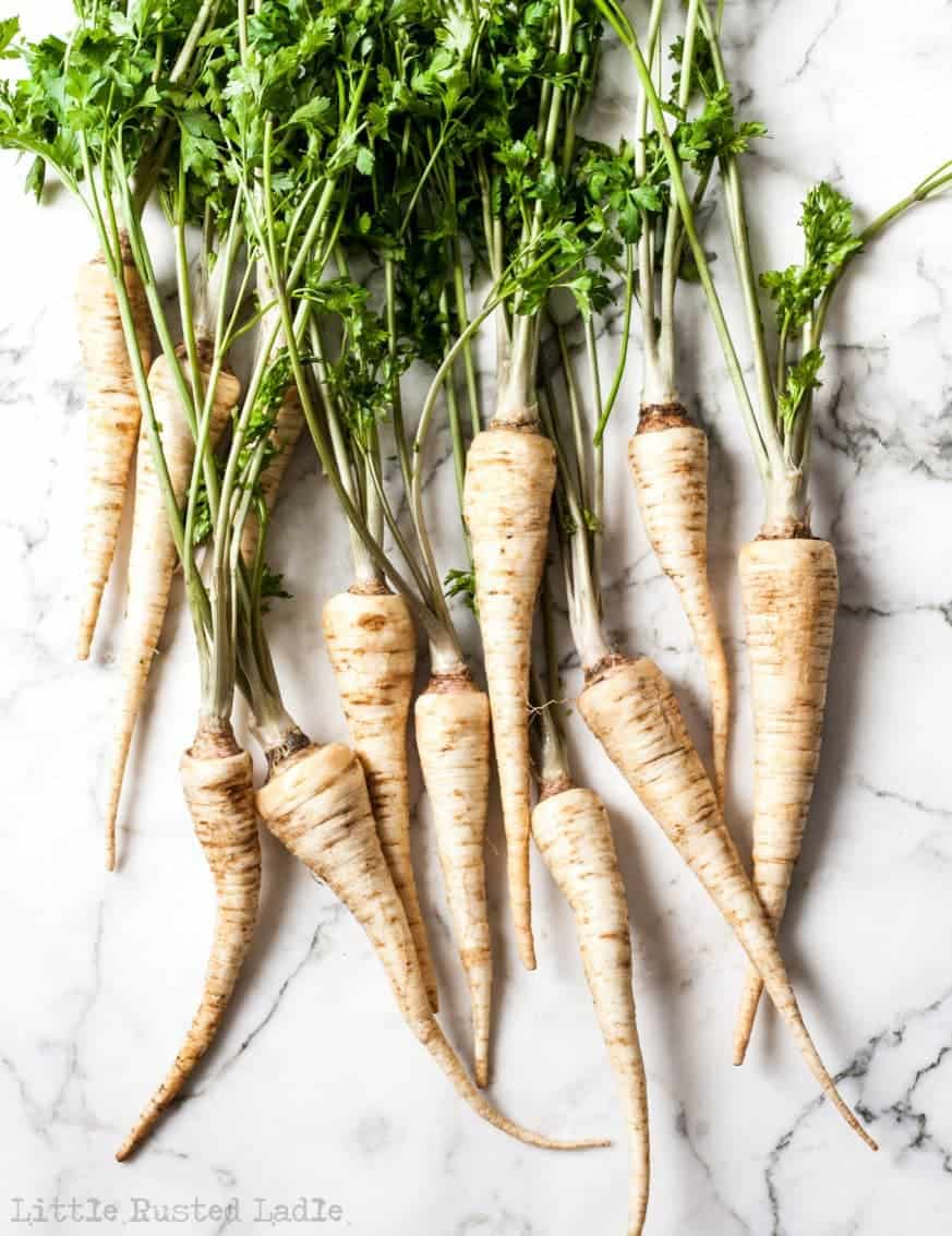 parsnips on white marble