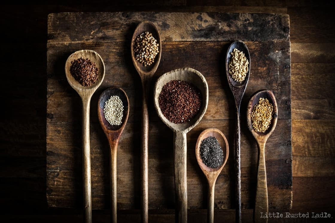 antique wooden spoons with ancient grains