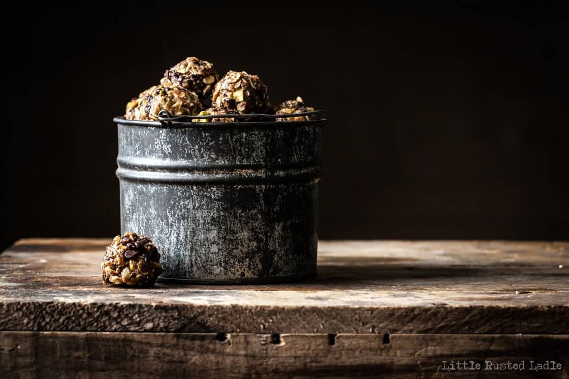 Metal bucket filled with little granola balls.