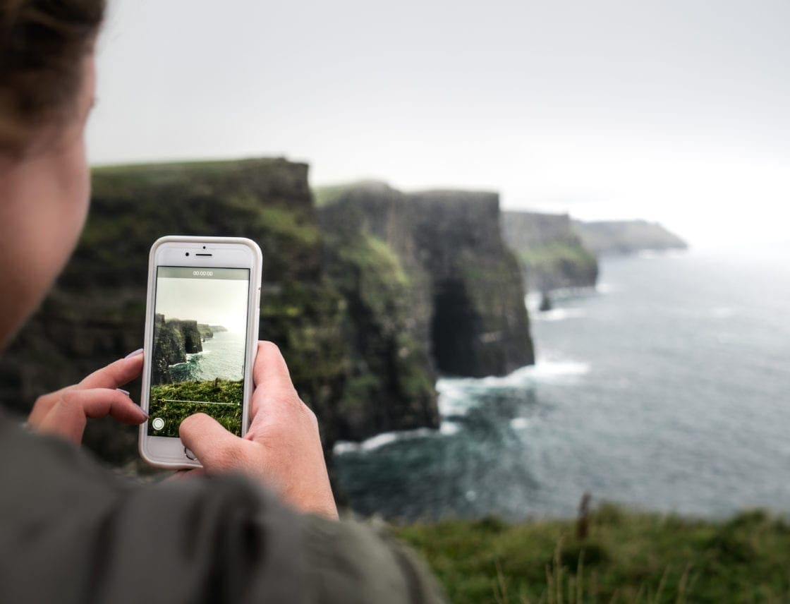 Taking a cell phone photo of the Cliffs of Moher