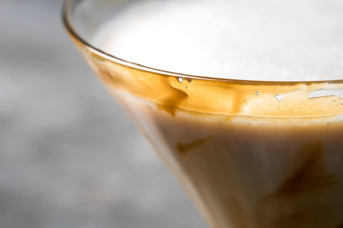 Close up detail of caramel on martini