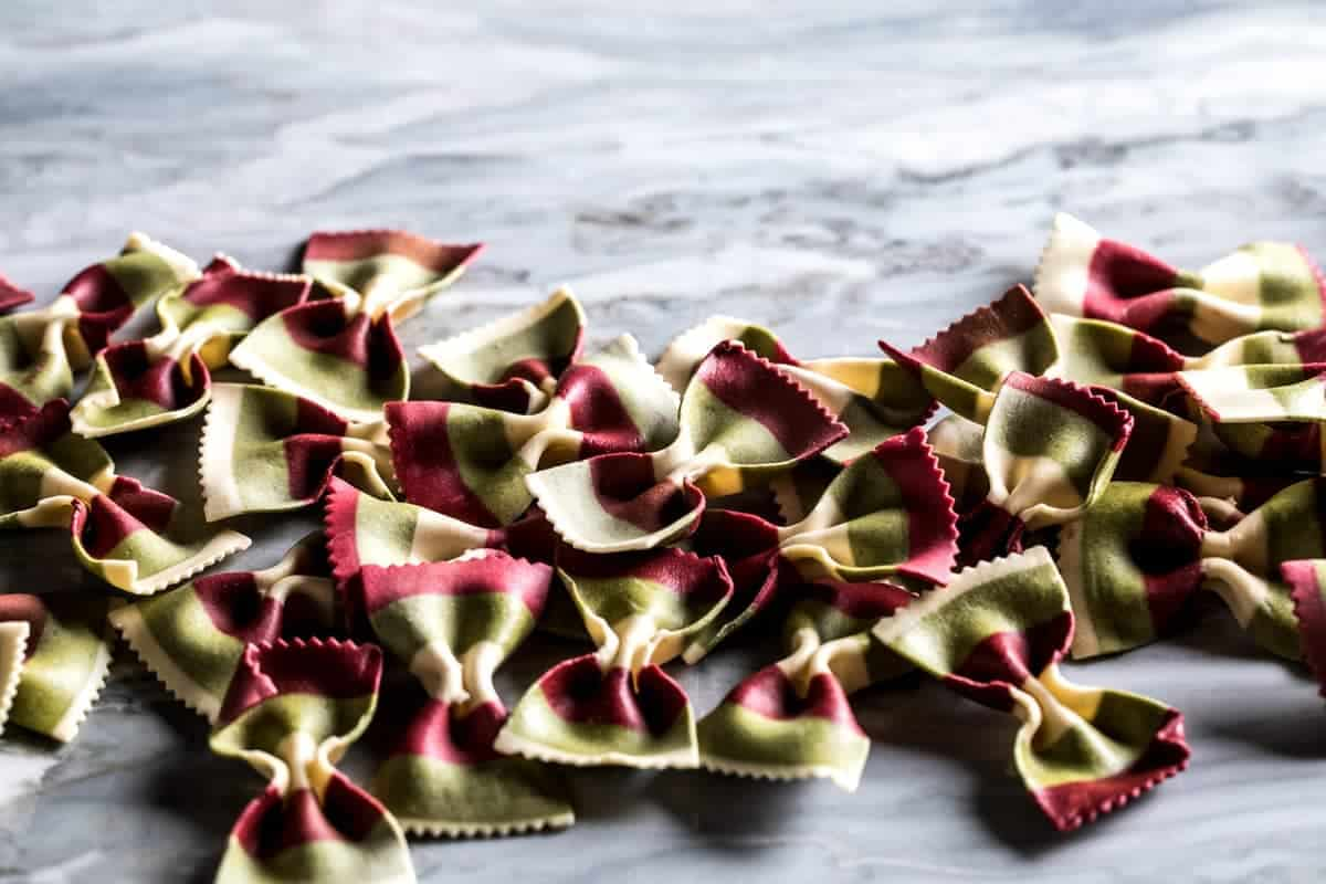 Tri-color bow tie pasta made with beets