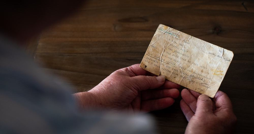 Grandma holding aged recipe card