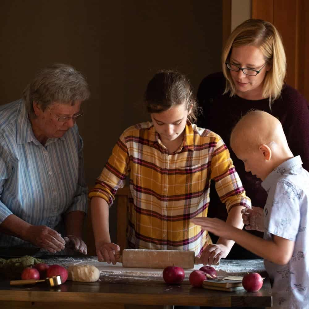 Family Baking together using rolling pin