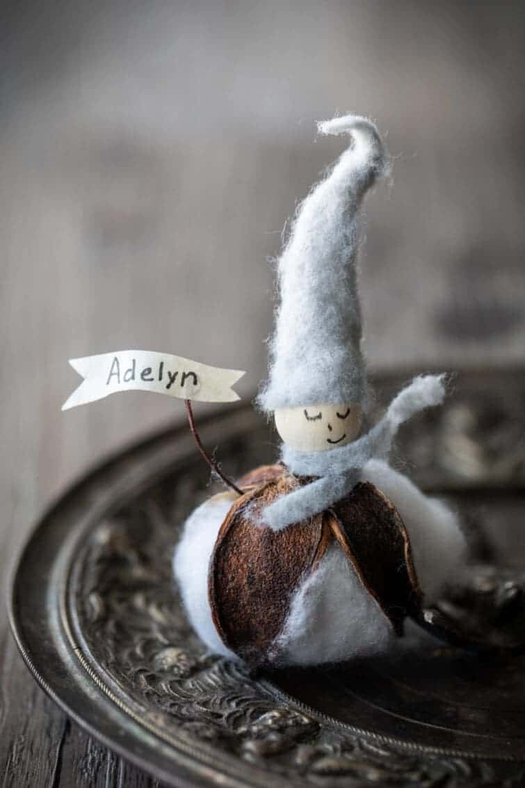 Place card with the base made from a cotton blossom with a wood bead head with gray felt hat. Handmade Gift