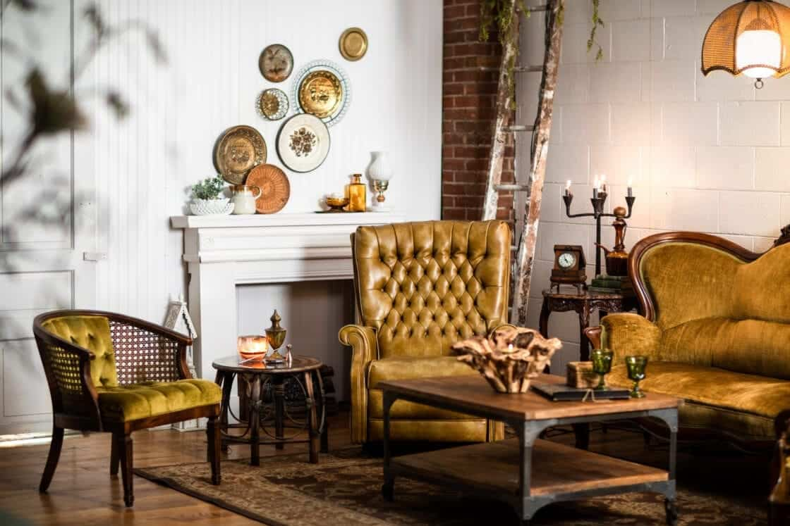 warm inviting client waiting area with beautiful rustic furniture, decor and exposed brick
