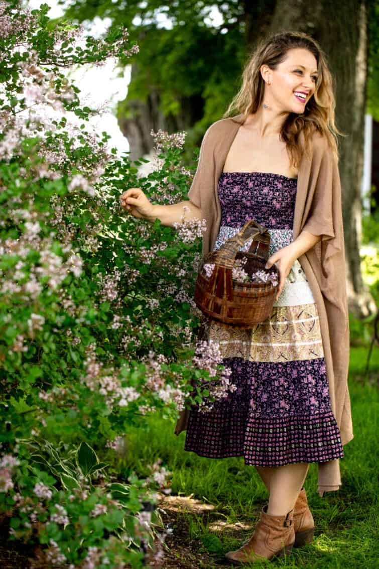 Jena Carlin outside with a basket picking lilacs for food photography shoot