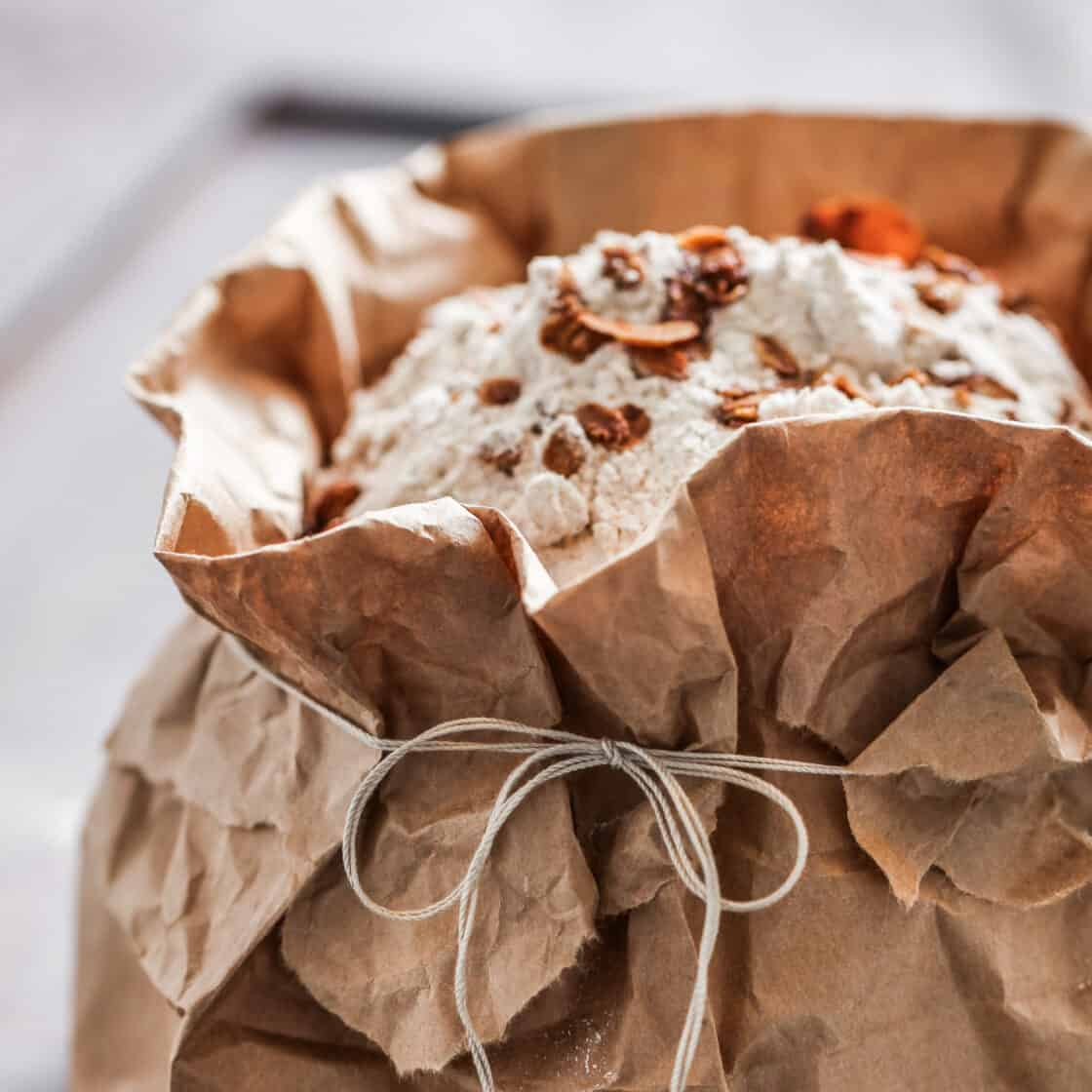 pancake mix recipe using whole wheat and maple granola in a brown paper bag