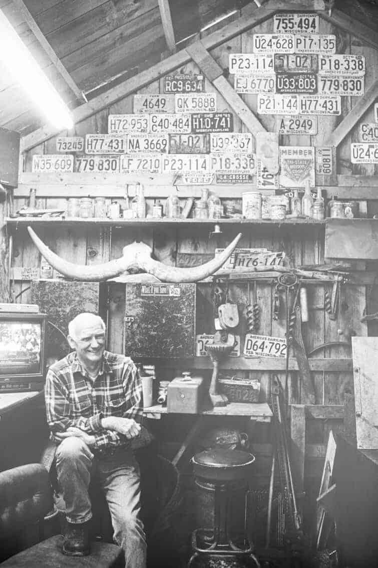 man at his maple syrup farm shack