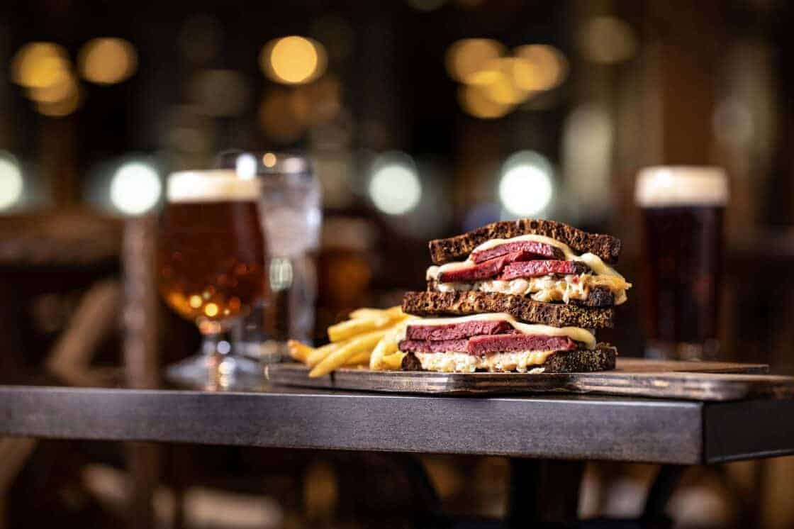 Reuben sandwich and fires in a bar setting