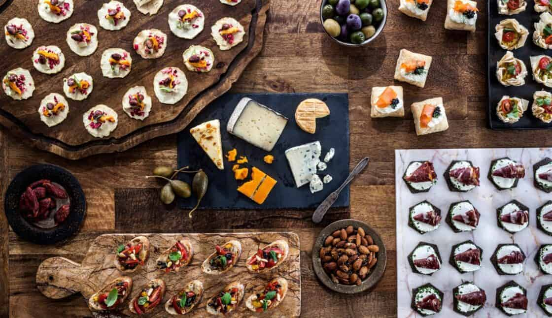 overhead shot of huge spread of fancy appetizers and cheese plate