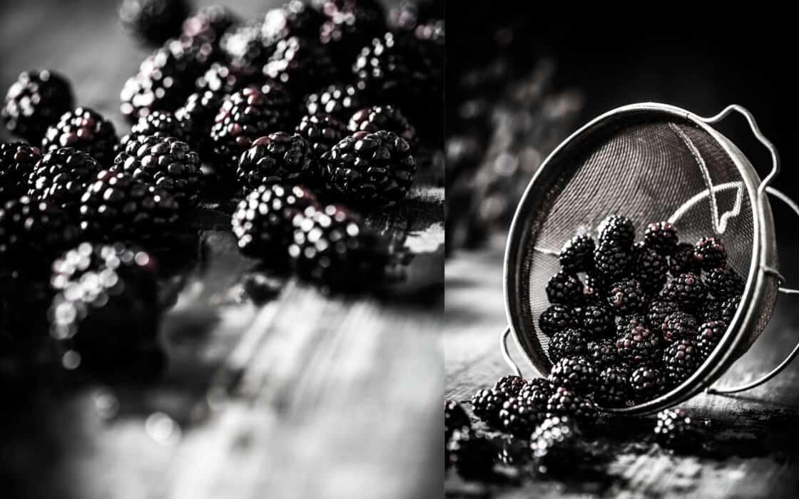 blackberries in a metal sieve