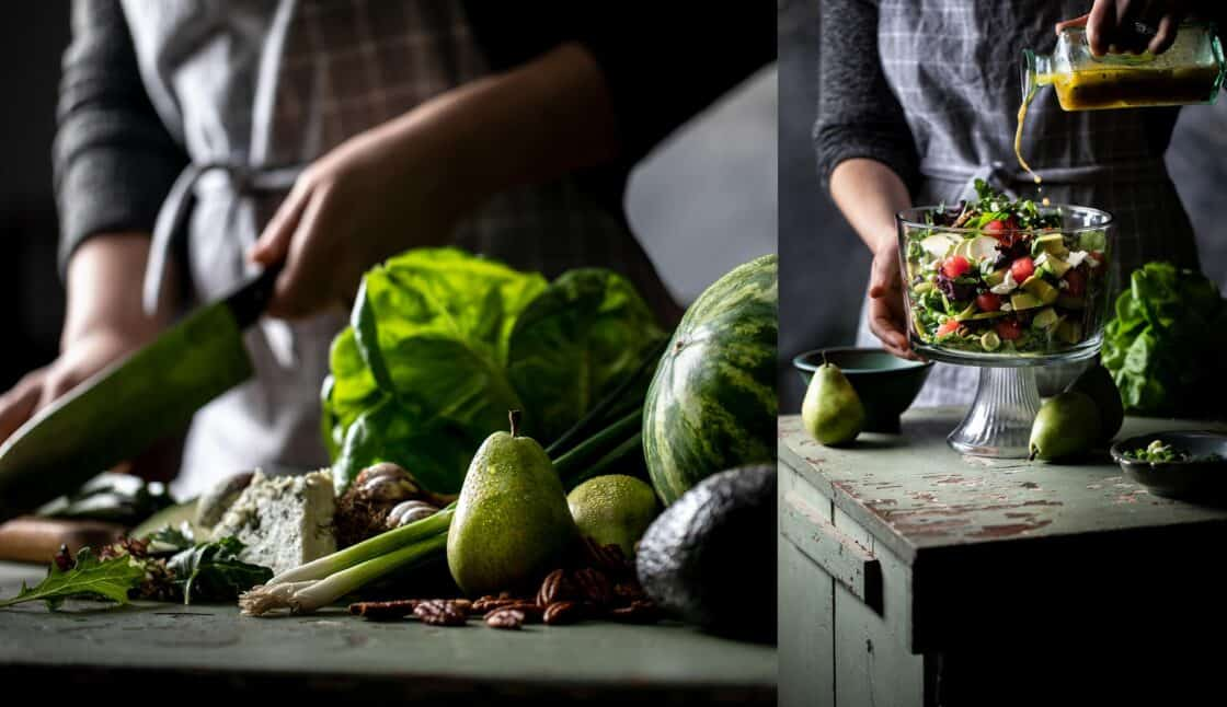 woman chopping vegetables and finishing a salad