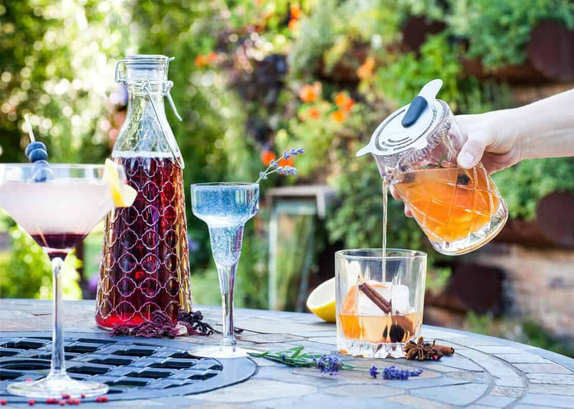 Pouring a cocktail at an outdoor party in summer