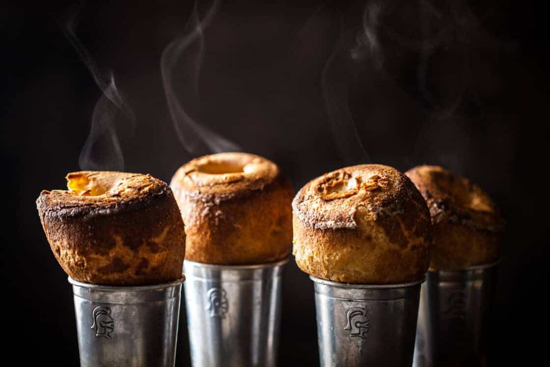 steaming cranberry popovers in their metal tins