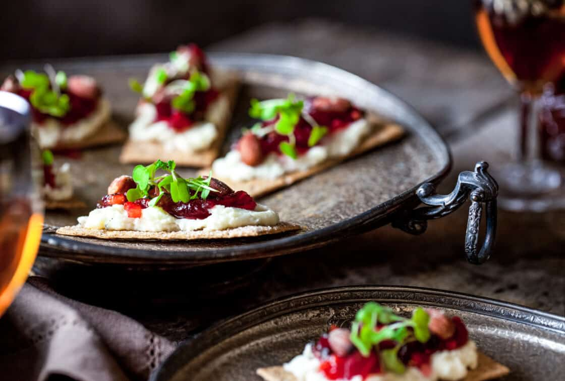 cranberry flatbread on antique metal dishes