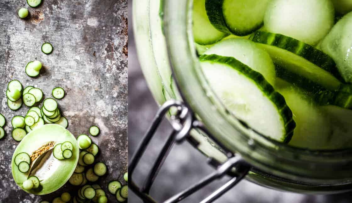 Overhead shot of cucumber melon infused gin in a glass jar with ingredients to the side