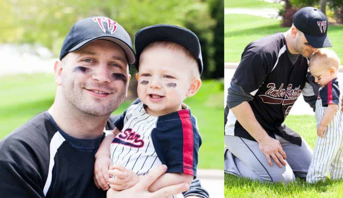 Dad and son in baseball otufits enjoying outside time