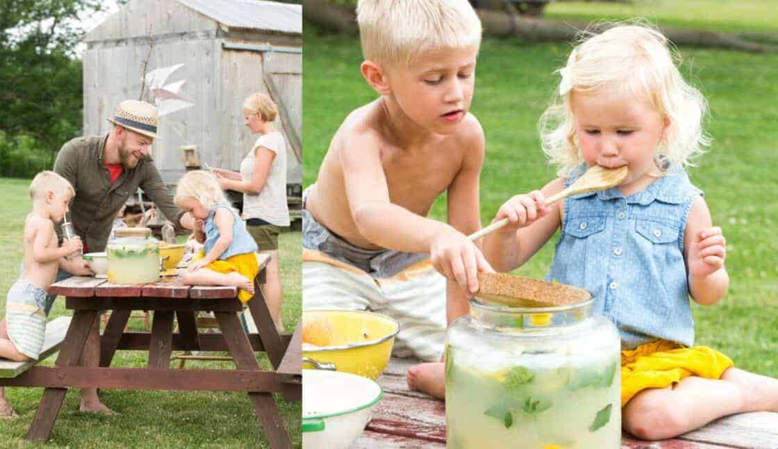 kids making lemonade at a farm table