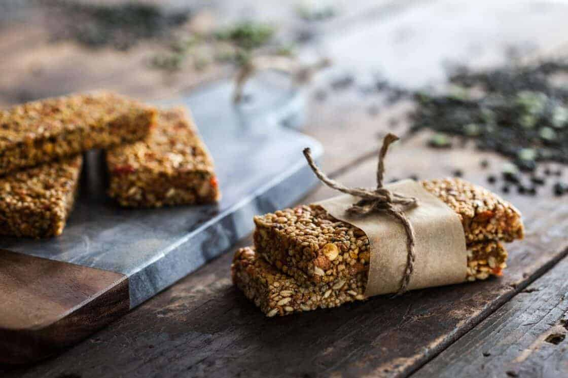neatly wrapped homemade granola bars on rustic surface