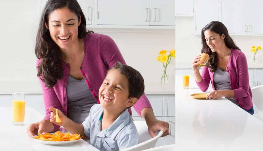 mom and son eating chips in white kitchen
