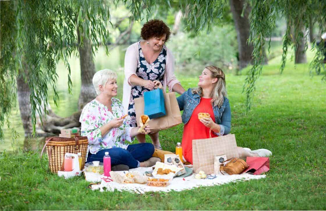 Three women having a picnic in a park