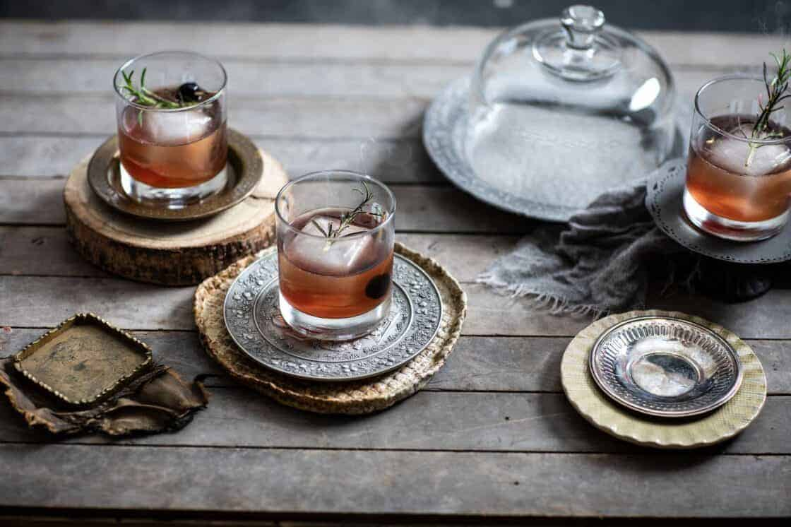 simple cocktails with large ice cubes in antique setting