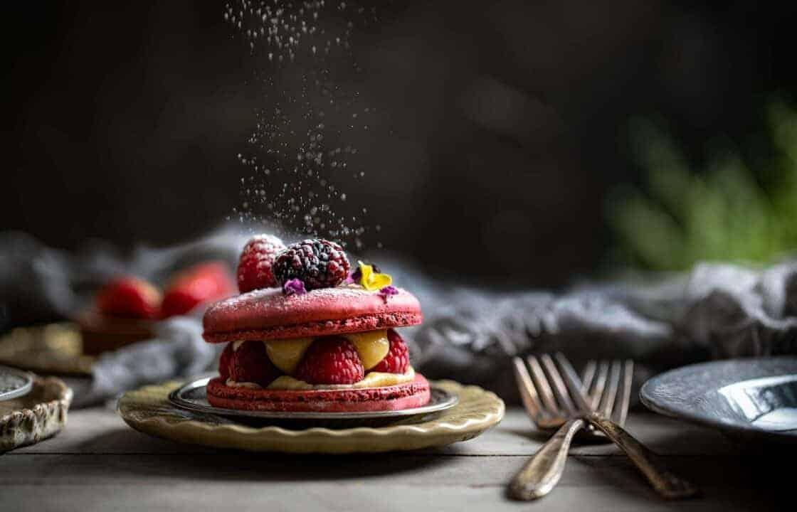 powdered sugar falling on a berry macaroon