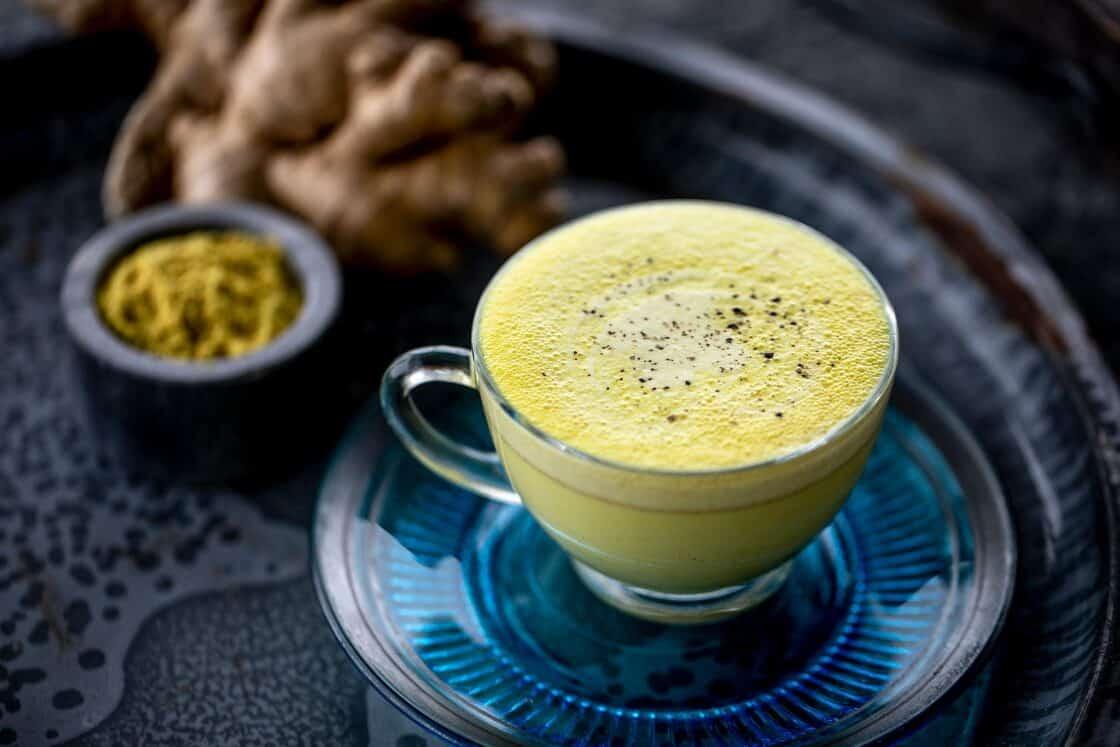 3/4 shot of glass teacup of turmeric chai tea