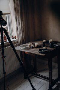 View of photo set near window in darkish room.