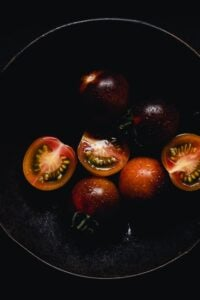halved cherry tomatoes in a moody setting