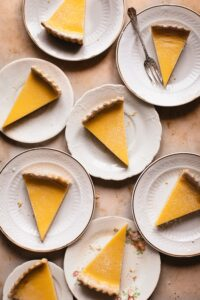 Overhead shots of pieces of lemon pie on white plates