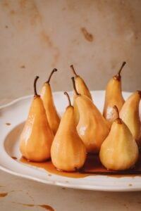Baked peaches on a plate with caramel sauce