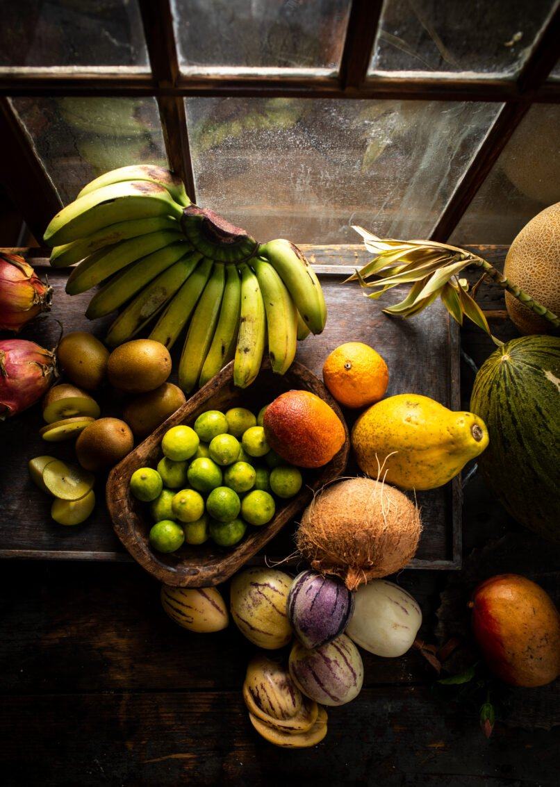 Overhead shot of tropical fruits by window food photography.