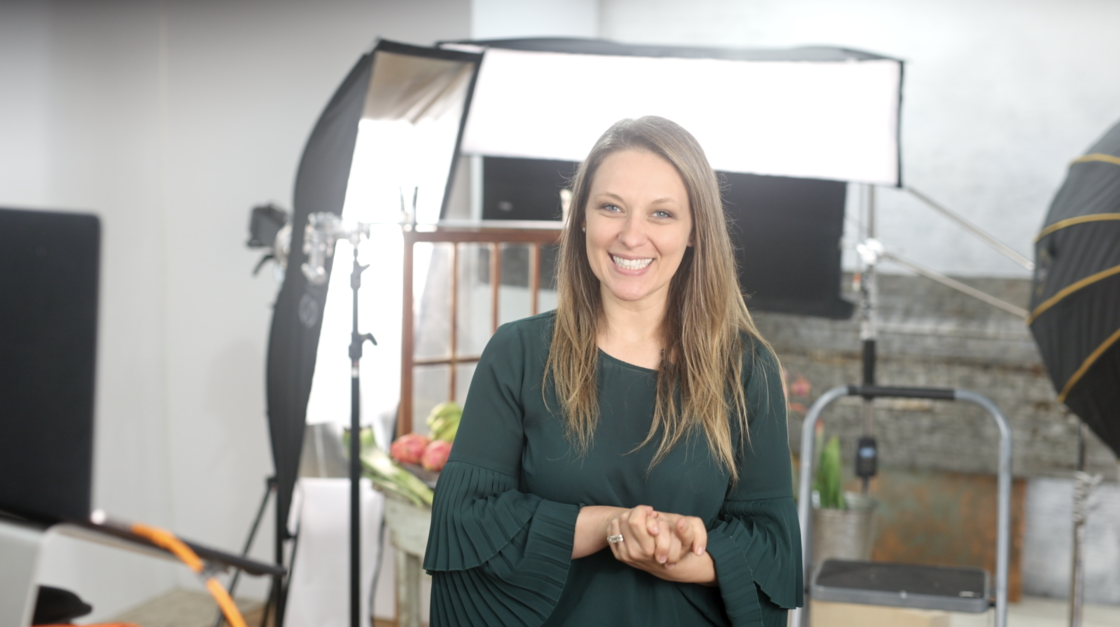Jena Carlin in front of artificial light food photography set
