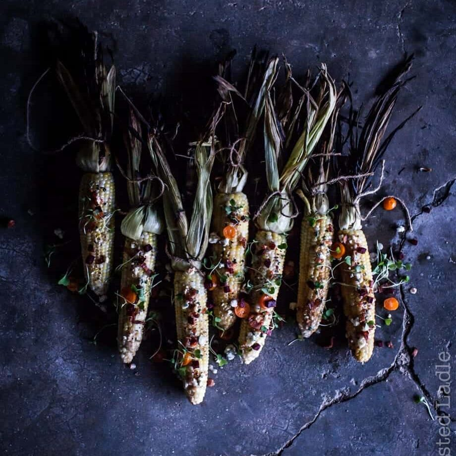 Fire Roasted corn on the cob with a moody background