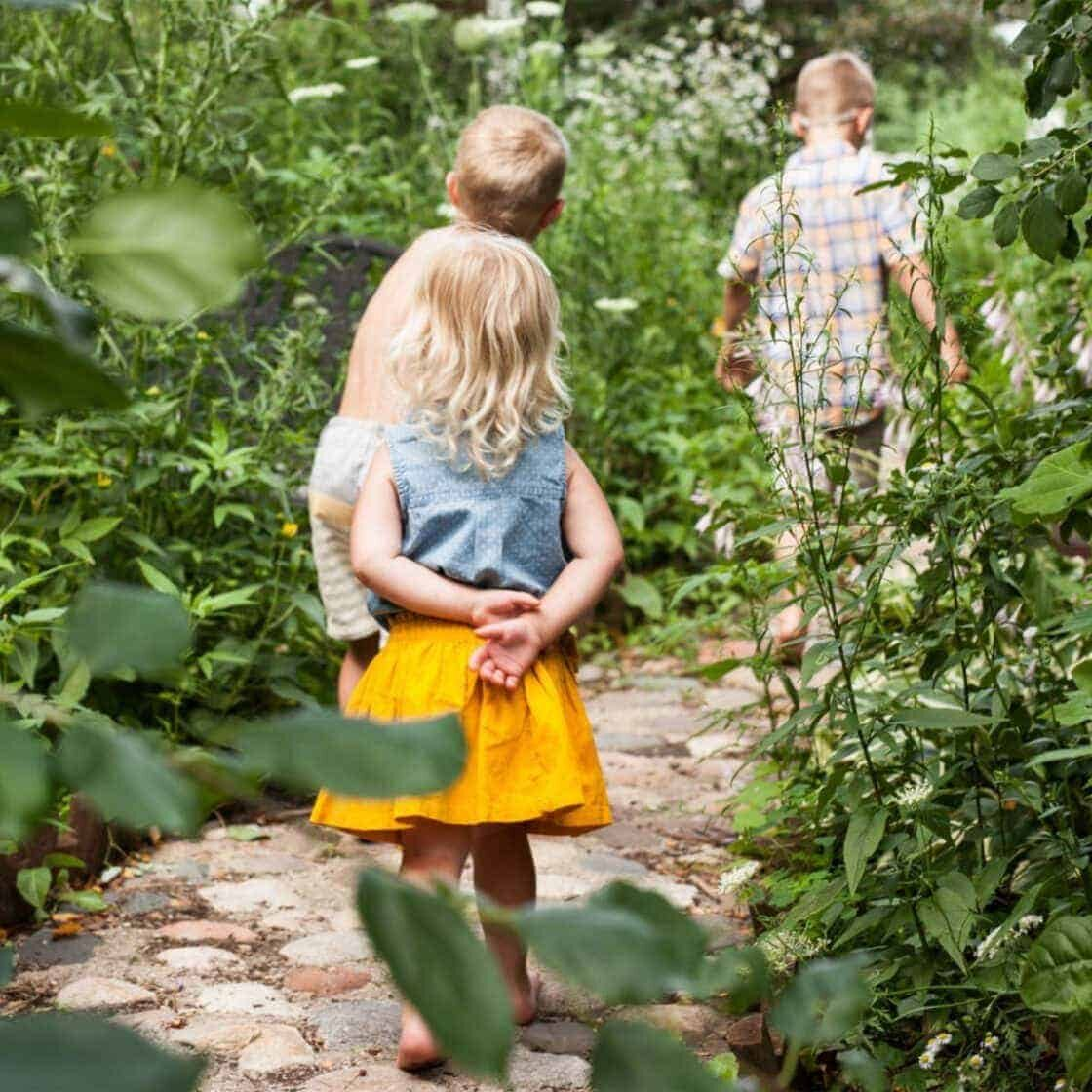 kids going through a garden path