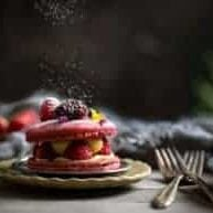 powdered sugar falling on a berry macaroon